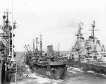 Battleship USS Iowa and carrier USS Shangri-La receiving fuel from oiler USS Cahaba, 8 Jul 1945