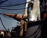 Shipyard worker working on a turret aboard battleship Iowa, New York Navy Yard, New York, United States, fall 1942