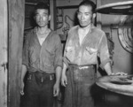 Two survivors of the sunken Jintsu, dressed in US Navy uniforms, aboard USS Nicholas (DD-449), 13 Jul 1943