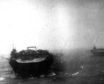 Kaga in heavy seas en route to Pearl Harbor, circa early Dec 1941; carrier Zuikaku in background