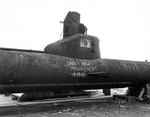A Kairyu-class submarine at Yokosuka Naval Base, Japan, 7 Sep 1945; note grafitti drawn by American personnel