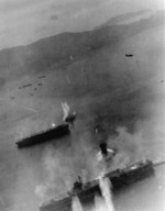 Kaiyo (center) under attack by SB2C Helldiver bombers from USS Essex, Kure, Japan, 19 Mar 1945; the carrier at bottom was either Amagi or Katsuragi