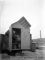 Close-up of a rocket launcher control cabin aboard HMS King George V while she was in drydock at Rosyth, Scotland, United Kingdom, circa 1940-1941
