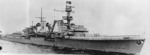 Light cruiser Köln underway with her rails manned, circa 1936; note the heraldic shield mounted on her bow