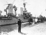 Königsberg at Swinemunde, Germany, with a sentry on guard in the foreground, 1938