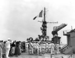 Raising of the French flag aboard the ex-USS Langley upon being commissioned as the La Fayette in the French Navy, Philadelphia Naval Shipyard, Pennsylvania, United States, 2 Jun 1951
