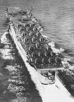 French carrier La Fayette arriving in France, 11 Sep 1951; note F6F-5, F6F-5N, and TBM-3E aircraft on flight deck; seen in Nov 1951 issue of US Navy Naval Aviation News