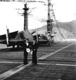 French sailors and TBW-3W Avenger aircraft aboard carrier La Fayette, 1962