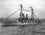 USS Idaho dressed with flags during the Naval Review off New York, New York, United States, Oct 1912