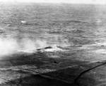 Damage to Lexington after bomb hit near the port forward 5-inch gun gallery, Battle of Coral Sea, 8 May 1942, photo 1 of 4