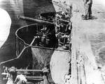 Damage to Lexington after bomb hit near the port forward 5-inch gun gallery, Battle of Coral Sea, 8 May 1942, photo 2 of 4