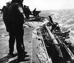 Damage to Lexington port side number six 5-in gun by dive bomb, Battle of Coral Sea, 8 May 1942, photo 1 of 2