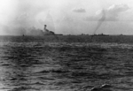 USS Lexington burning as she was being abandoned, 8 May 1942, photo 2 of 2; note USS Chester and other warships nearby