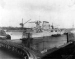 USS Lexington fitting out at the Bethlehem Steel Company shipyard at Quincy, Massachusetts, Nov 1927; note merchant ship West Grama at right edge of photo