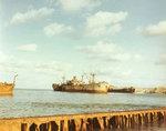Liberty Ship IX-229 Inca/IX-227 Gamage and LST-823 aground and stripped in Buckner Bay, Okinawa, late 1940s