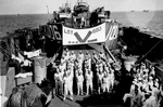 African-American members of the US Army Air Forces 1909th Engineers Aviation Battalion aboard LST-683, 15 Aug 1945