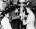 Visitors looking through the periscope of USS Macabi at Mare Island Naval Shipyard, California, United States, Armed Forces Day, 19 May 1956