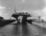 USS Makin Island entering floating drydock ABSD-6 for repairs and paint at Guam, Mariana Islands, 8 Jun 1945