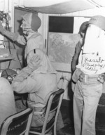 Crew members of USS Makin Island at their battle stations with inflatable belts and flash proof clothing, late 1944-mid 1945