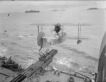 Walrus seaplane being launched from HMS Mauritius, date unknown, photo 1 of 2