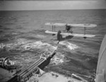 Walrus seaplane being launched from HMS Mauritius, date unknown, photo 2 of 2