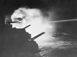 HMS Mauritius firing on German targets in Audierne Bay, France, 23 Aug 1944
