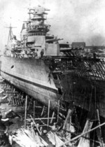 Light cruiser Maxim Gorkiy receiving a new bow after mine damage, Kronshtadt, Russia, 3-21 Jul 1941