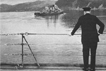 Winston Churchill watches the McDougal as the ship transported Roosevelt back to the US