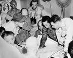 American and Japanese officers reviewed charts of Sagami and Tokyo Bays aboard Missouri, 27 Aug 1945