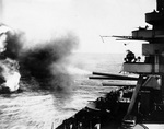 Battleship New York bombarding Iwo Jima, 16 Feb 1945; view looked aft, on the starboard side