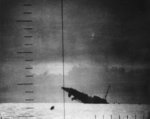 Japanese Patrol Boat #39 sinking after being torpedoed by American submarine Seawolf, 23 Apr 1943; seen from Seawolf