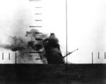 Japanese cargo ship Nittsu Maru sinking in the Yellow Sea, off China, after being torpedoed by American submarine USS Wahoo, 23 Mar 1943; photo taken from Wahoo