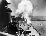 USS North Carolina firing her forward guns during trials, 26-27 Aug 1941