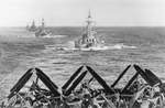 US Navy Task Group 38.3 entering Ulithi anchorage in a column following strikes in Philippine Islands, 24 Dec 1944, photo 6 of 7
