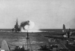 USS North Carolina bombarding Nauru, 8 Dec 1943; note OS2U Kingfisher aircraft in foreground