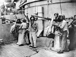 20mm Oerlikon crews at the base of one of the main turrets aboard USS North Carolina, 1942; note African-American crewmen