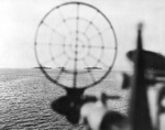 Australian heavy cruisers Shropshire and Australia seen through a gunsight of American cruiser Phoenix, off Leyte, Philippine Islands, 21 Oct 1944