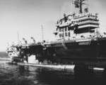 USS Pompon and USS Thornback receiving supplies from USS Saratoga, 17 Aug 1958
