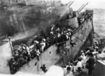 Crew of HMS Prince of Wales escaping from the sinking battleship, off Malaya, 10 Dec 1941