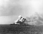 Light cruiser Reno approached the burning light carrier Princeton, off the Philippine Islands, at 1004 on 24 Oct 1944; photographed from battleship South Dakota
