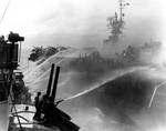 Birmingham attempted to fight fires aboard Princeton, 24 Oct 1944, photo 1 of 2