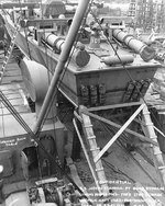 PT-109 stowed on board the Liberty Ship Joseph Stanton for transportation to the Pacific Ocean, Norfolk Navy Yard, Virginia, United States, 20 Aug 1942, photo 2 of 2