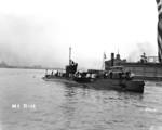 USS R-14 in port, 1941; note tug W. F. Dalzell in background