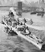 French battleship Richelieu, maneuvered by tugboats, arriving in New York, New York, United States for repairs, early 1943