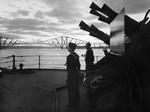 View of 2-pdr gun and two sailors aboard HMS Rodney, Firth of Forth, Scotland, United Kingdom, Oct 1940