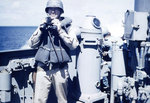 Lieutenant Howard W. Whalen holding binoculars aboard USS Sanborn, 1945, photo 2 of 2