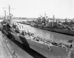 USS San Diego at Mare Island Naval Shipyard, Vallejo, California, United States, 9 Apr 1944, photo 1 of 2; note camouflage Measure 33, Design 24d; USS Cassin and USS Denver in background
