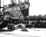 Japanese working party rigging the gangway for USS San Diego, Yokosuka, Japan, 30 Aug 1945