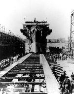 San Jacinto sliding down the building ways at Camden, New Jersey, United States after she was christened by Mrs. Jesse H. Jones, 26 Sep 1943