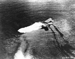 Saratoga sinking after atomic bomb blast, Bikini Atoll, Marshall islands, 25 Jul 1946, photo 1 of 2